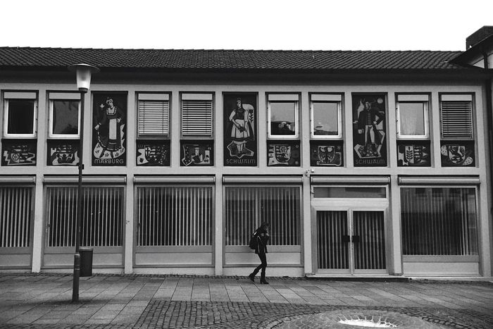 Streetphoto_bw Peoplephotography People In Transit People In Geometries Grid Façade Architectural Detail Lerone-frames Rule Of Thirds Old Modernity Architecture_bw