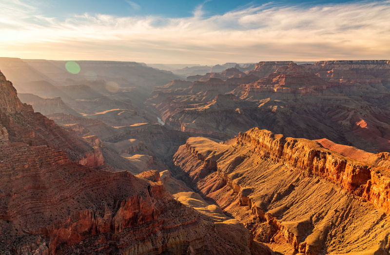 The Grand Canyon Cloud Colorado Grand Canyon Red Rock View Canyon Cloud - Sky Eroded Landscape Lens Flare Lensflare Mountain Nature No People Physical Geography River Rock Formation Scenics - Nature Sun Sunset Travel Travel Destinations Valley Viewpoint
