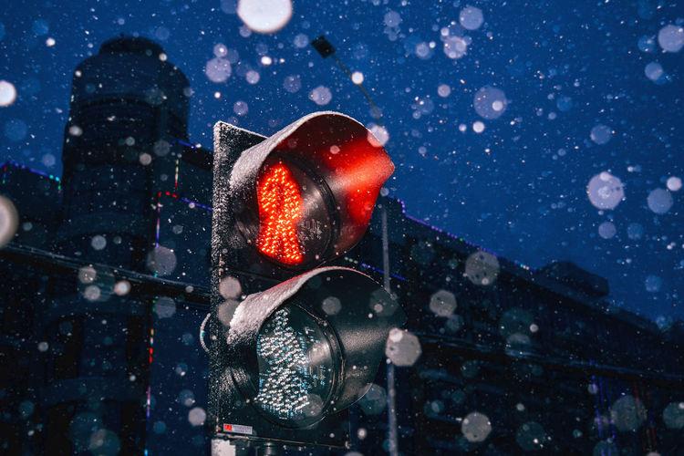 Illuminated signal on road at night