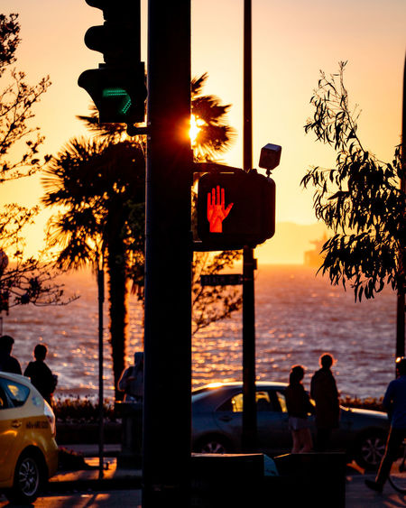 Sunset Tree Sky Sea Water Nature Silhouette Mode Of Transportation Car Plant Orange Color Men Transportation Motor Vehicle Group Of People Real People Outdoors Sun Tropical Climate