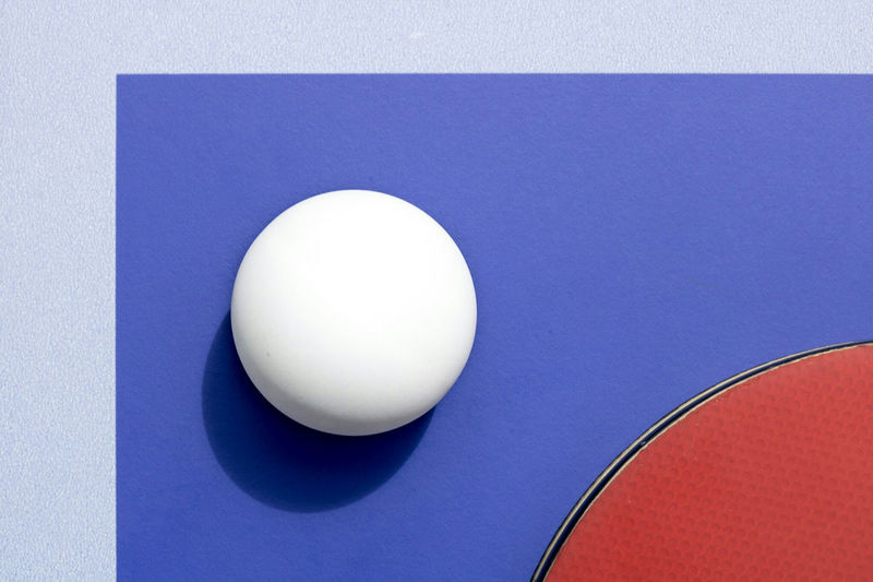 Close-up of table tennis racket with ball