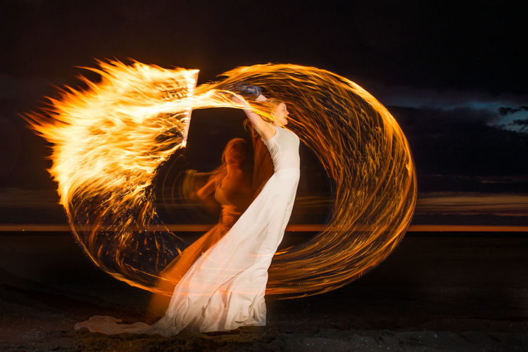 Woman with fire at beach