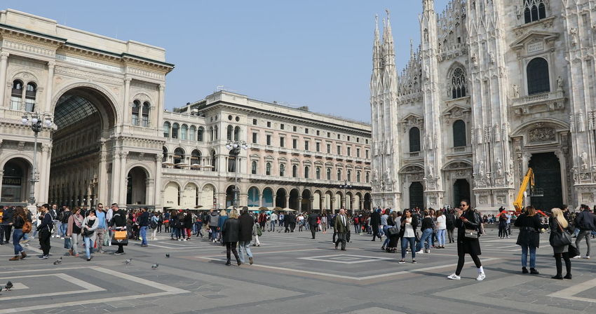 MILAN, ITALY- MARCH 7, 2017: Tourists walking and taking pictures with pigeons in Piazza Duomo of Milano fashion city. Ground view of this historic Gothic cathedral. tourists walking for shopping inside the Galleria Vittorio Emanuele II gallery in Piazza Duomo square. Famous fashion stores like Prada. Luxury and shopping concept. Cathedral Church City Duomo DuomoDiMilano Fashion Italia Milan Milan Italy Milan,Italy Milano Milano Italy Square Vittorio Emanuele II Vittorio Emanuele II Gallery Arch Architecture Building Exterior Built Structure City Crowd Dome Duomo Di Milano Duomo Square Galley Group Of People History Italy Italy❤️ Large Group Of People Lifestyles Men Milanocity Outdoors Real People Sky Statigram The Past Tourism Tourist Travel Travel Destinations Visit Women