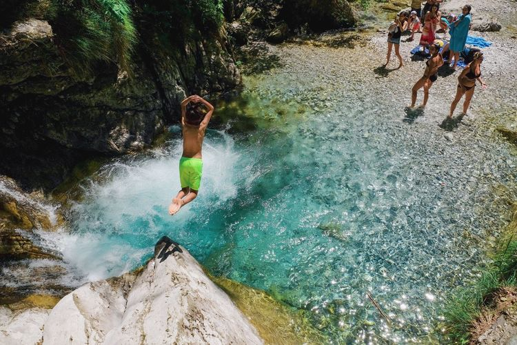 Jump in! Water Real People Leisure Activity Nature Lifestyles Motion Day Fun Enjoyment People Group Of People Outdoors Sport Vitality Clothing Splashing The Traveler - 2018 EyeEm Awards
