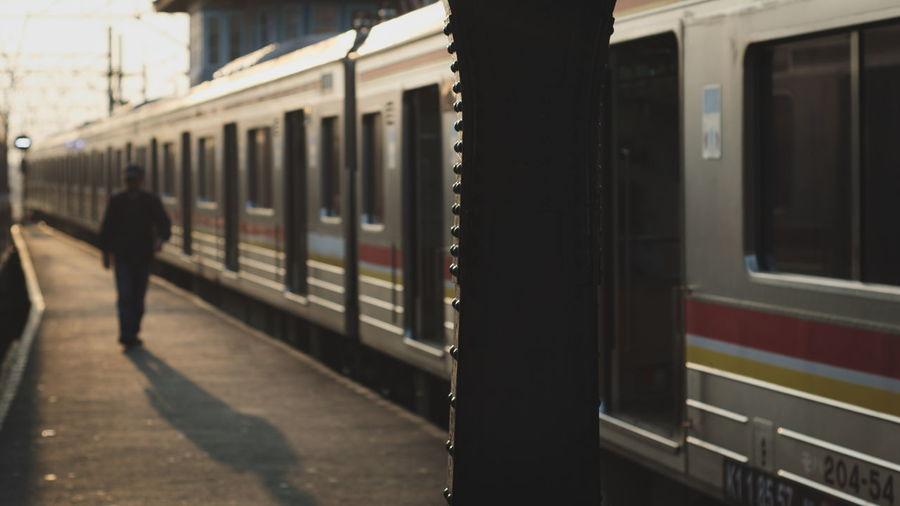 Full length of man at railroad station