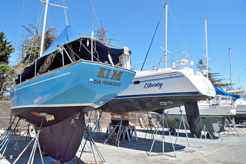 Boatyard @ Berkeley Marine Center 4 Berkeley, Ca. Boat Repair And Restoration Custom Yacht Builder Boats In A Line Boats Yachts Keels  Hulls Masts Boats On Stands Boatyard Colorful Boats Water Craft Sailboats Sails Tarps Not Quite Ready For Water