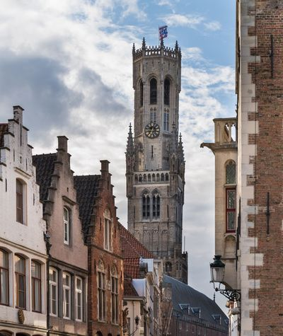 When There. Architecture Building Exterior Cloud - Sky Built Structure Sky Clock Tower History Low Angle View Travel Destinations Day No People City Outdoors Clock Belfort Brugge Bruges Belgique Belgium. Belgique. Belgie. Belgien. Etc. Belgium Tower Streetphotography