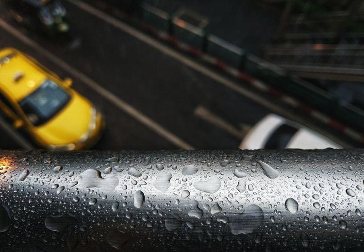 Close-up of wet car windshield during rainy season