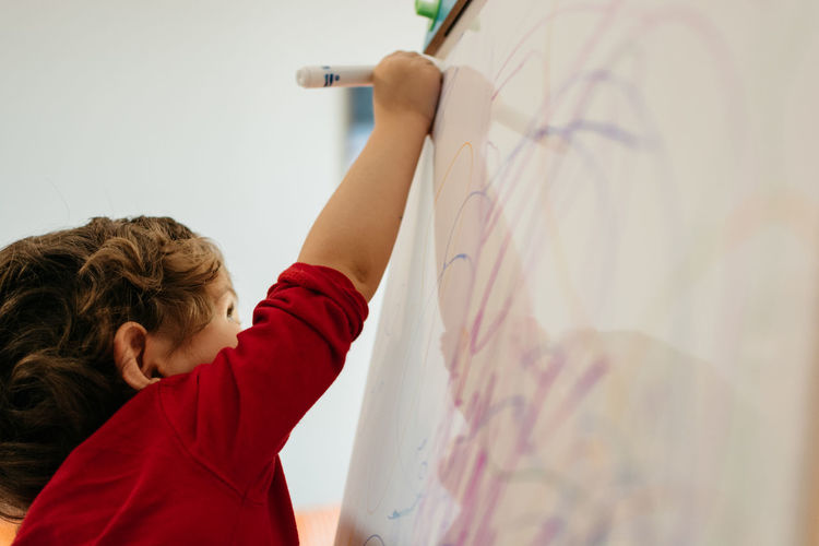 Boy Drawing On Whiteboard