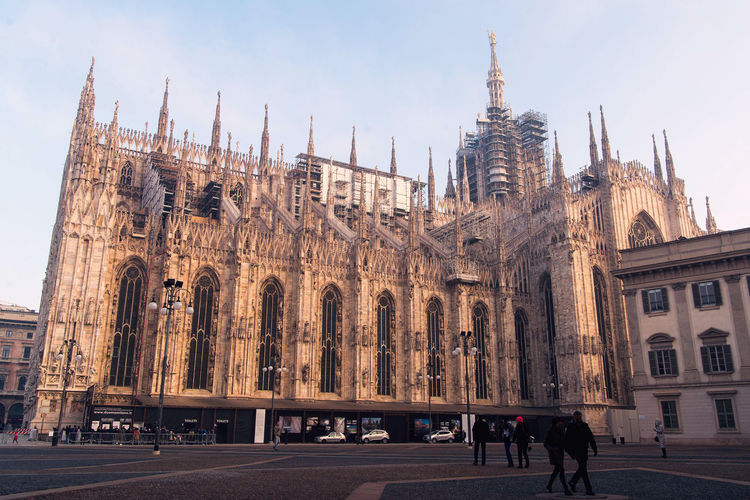 Milan Duomo Cathedral facade, marble carvings Architecture Built Structure Building Exterior City Sky Building The Past Place Of Worship Religion History Real People Group Of People Travel Destinations Belief Nature Men Tourism Travel Outdoors Gothic Style