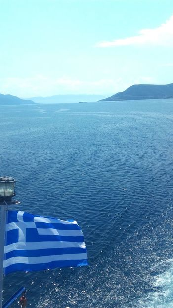 Sea Water Blue Outdoors Sky Day Greece Boat Flag Greek Flag Enjoying Life EyeEm Summer Vacations Urbanphotography Sea And Sky Colors Boats Like4like Likeforlike Mountain