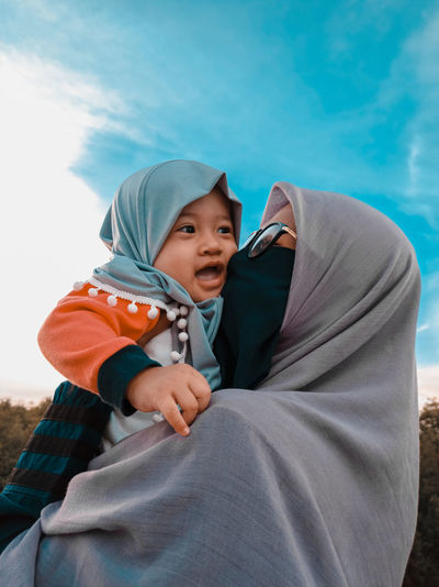 The happiness of a woman wearing a hijab when she is with her daughter