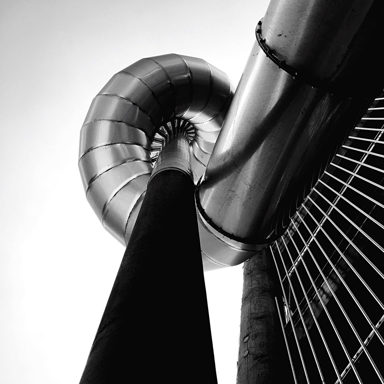 Low Angle View Of Industry Pipe Against Clear Sky