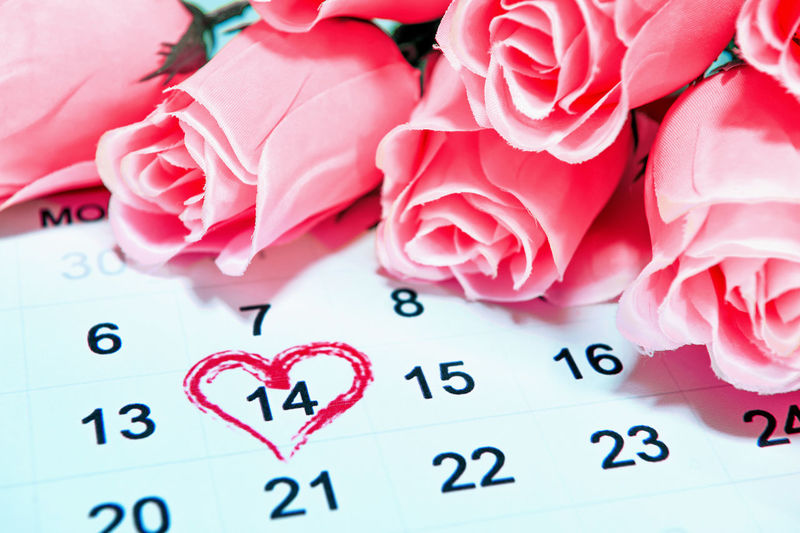 Close-up of roses on calendar