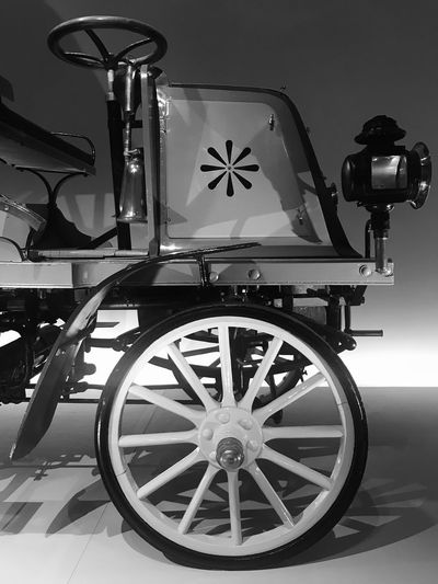Black & White Oldtimer Black And White Black Car Wheel Transportation No People Land Vehicle Mode Of Transportation Shape Wall - Building Feature Star Shape Geometric Shape Communication Close-up Medical Equipment Outdoors Circle Cart Metal Stationary Arts Culture And Entertainment Retro Styled