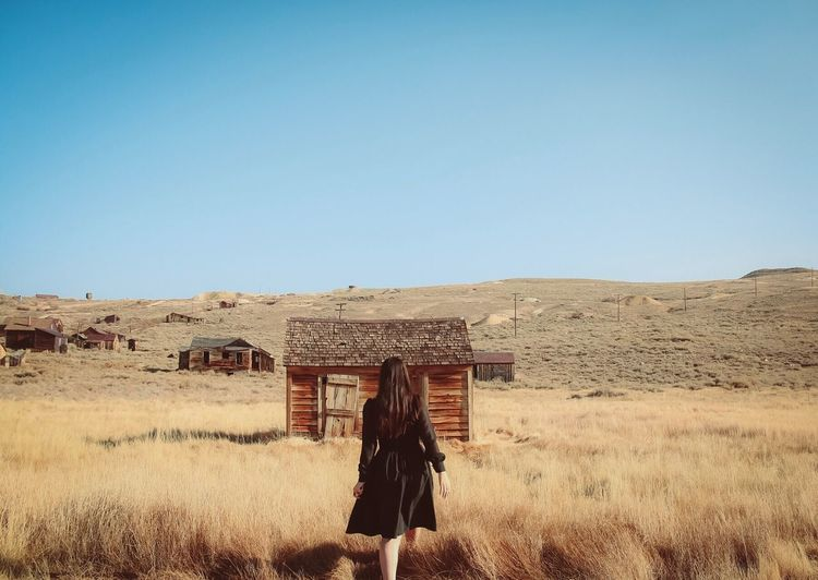 This house is not a home. Real People Sky Nature Copy Space Clear Sky Day Land Sunlight Landscape Standing Women Field Outdoors Adult Lifestyles Environment 2018 In One Photograph