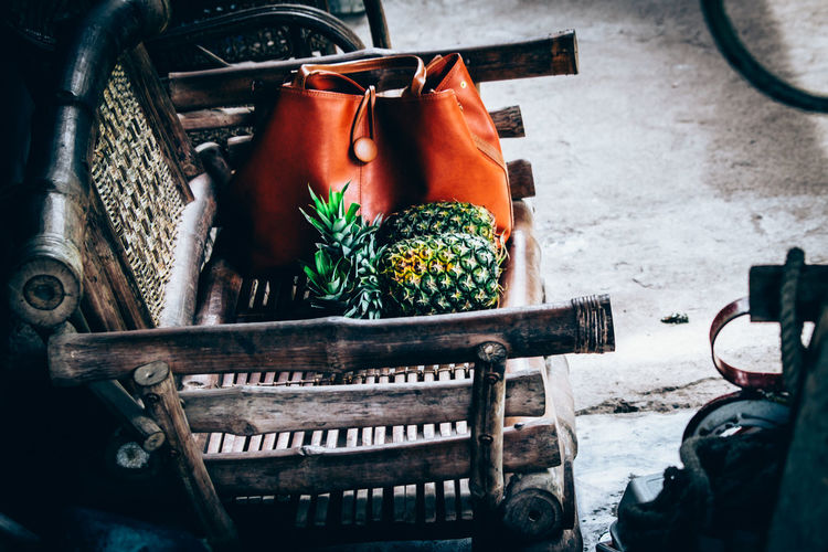 Pineapple And Brown Purse On Chair