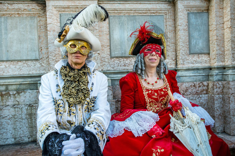 Carnival Carnival In Venice Venice, Italy Adult Adults Only Architecture Bride Building Exterior Built Structure Carnival Costumes Day Front View Lifestyles Looking At Camera Mask Outdoors People Portrait Real People Red Smiling Togetherness Two People Young Adult Young Women
