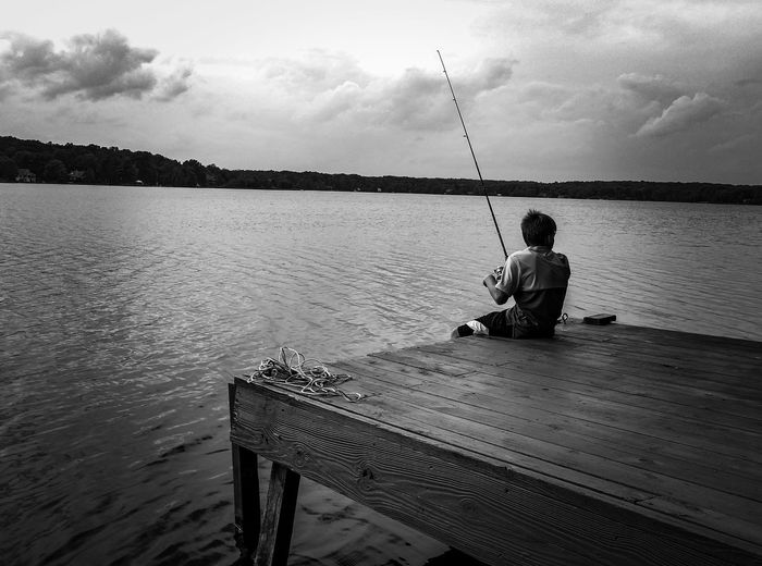 Did you see it jump?!! One Person Water Fishing People One Man Only Sky Adult Men Sea Real People Sitting Outdoors Full Length Fisherman Only Men Day Childhood Nature Fish Fishing A Boy And His Pole Fishing Pole Pocono's Pa. USA