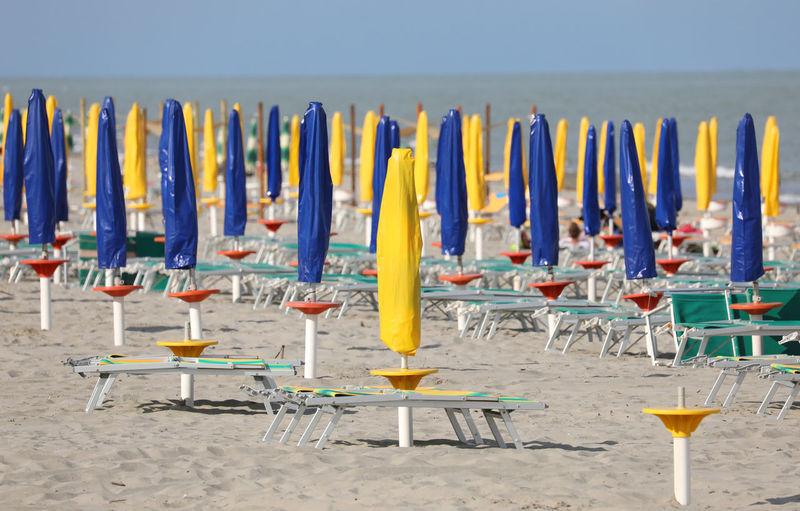 Row of chairs on beach