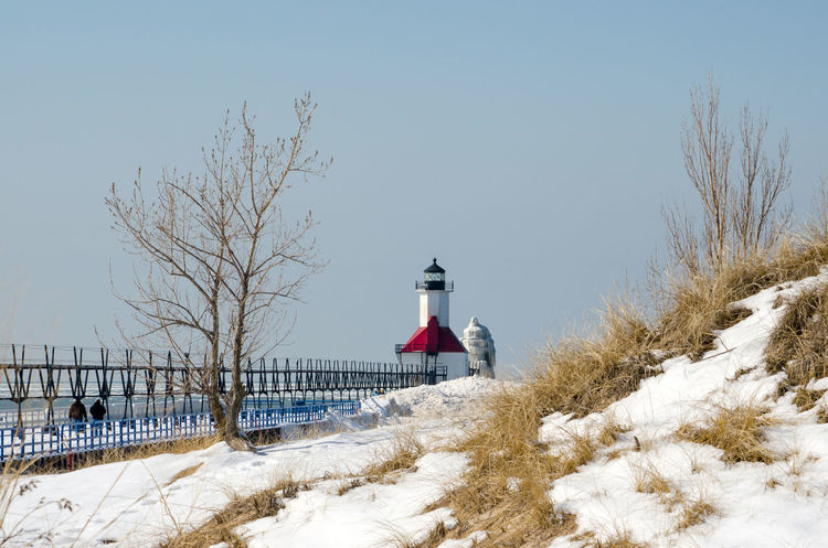 beautiful winter landscape with the st joseph lighthouse in the distance on the edge of lake michigan USA Mother Nature Nature USA Winter America Architecture Beauty In Nature Beauty In Nature Built Structure Cold Cold Temperature Frosted Trees Iced Landscape Icy Landscape Lighthouse Outdoors Outdoors Photograpghy  Scenics Seasonal Snow St Joseph Lighthouse Trees And Nature White