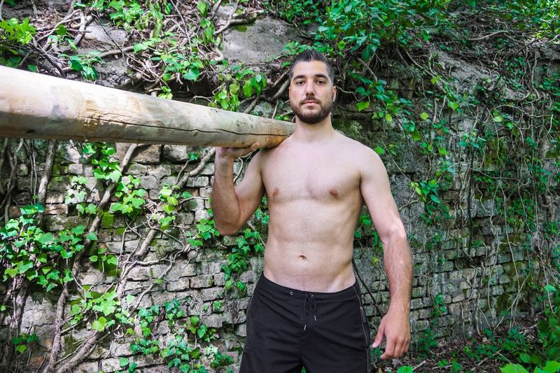 Portrait Of Young Man Carrying Wood