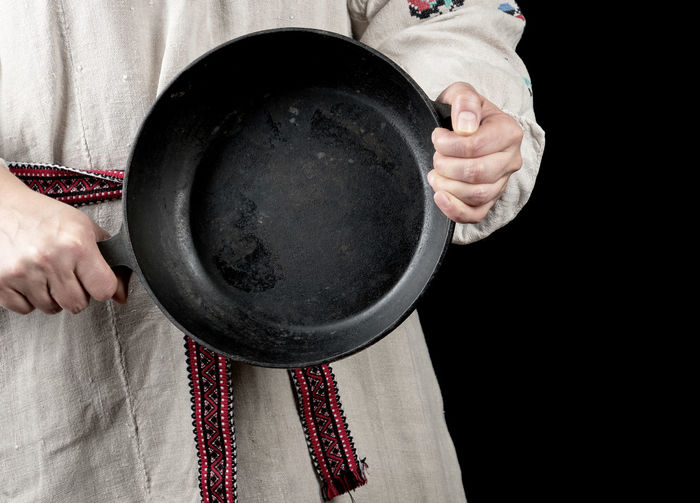 Midsection woman person holding frying pan
