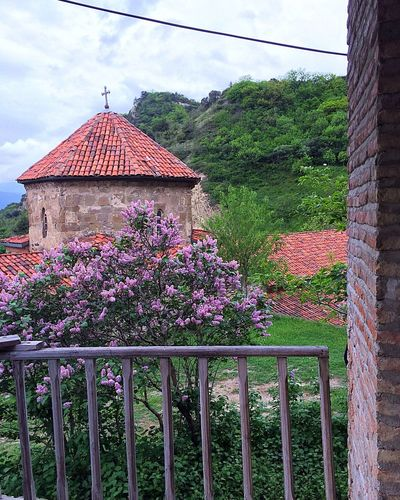 Architecture Built Structure Nature Flower Building Exterior Cloud - Sky Beauty In Nature Outdoors Eye4photography  Landscape_Collection From My Point Of View Purple Flowers Lilac Monastery Springtime Travel Destinations Travel Photography Tiled Roof