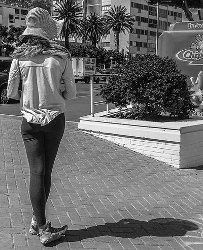 B&w Candid Candid Photography Crosslegged Full Length Hat Real People Shadow Sidewalk Standing Streetphotography