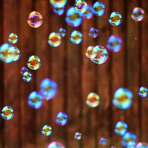 Bubbles against wooden wall