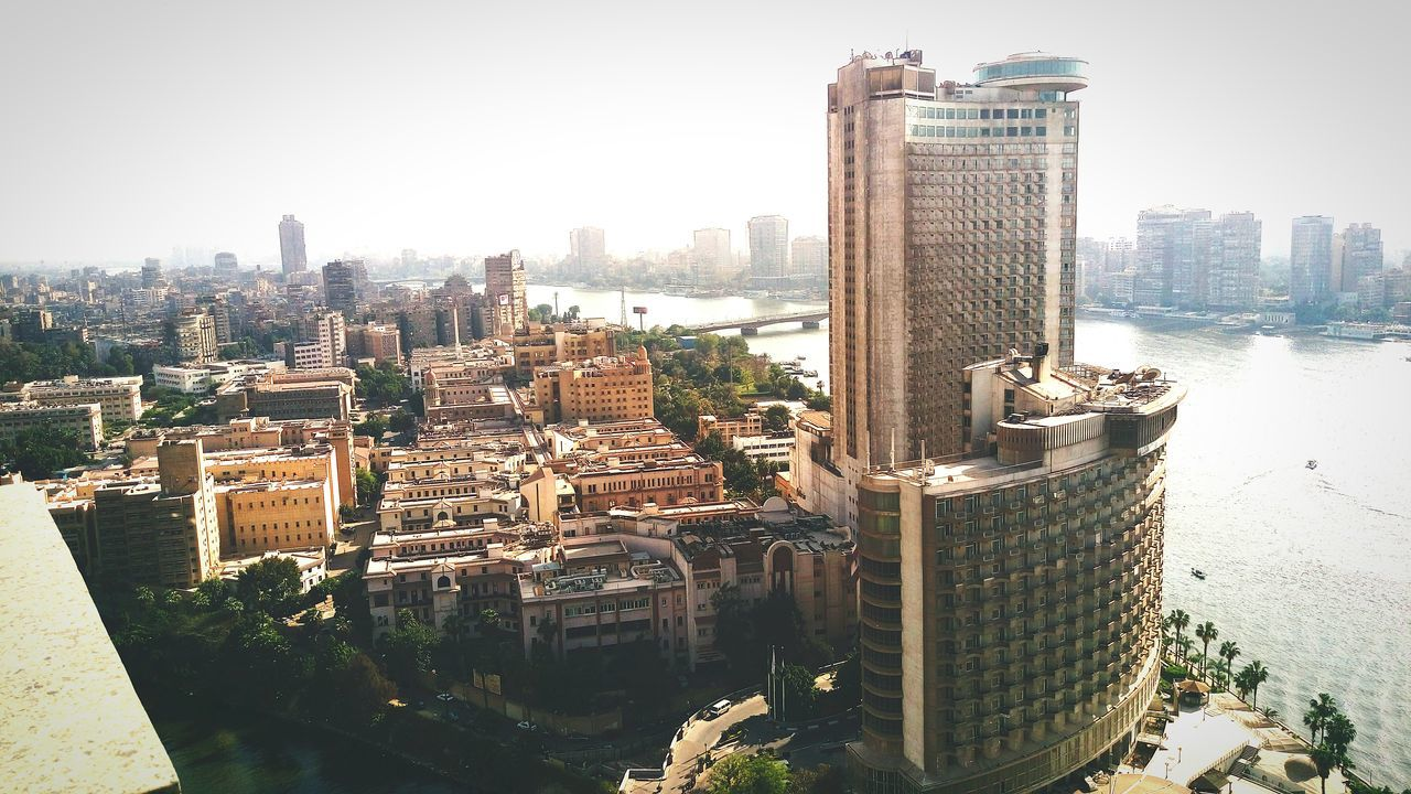 Grand Nile Tower Hotel Amidst Buildings During Sunny Day In City