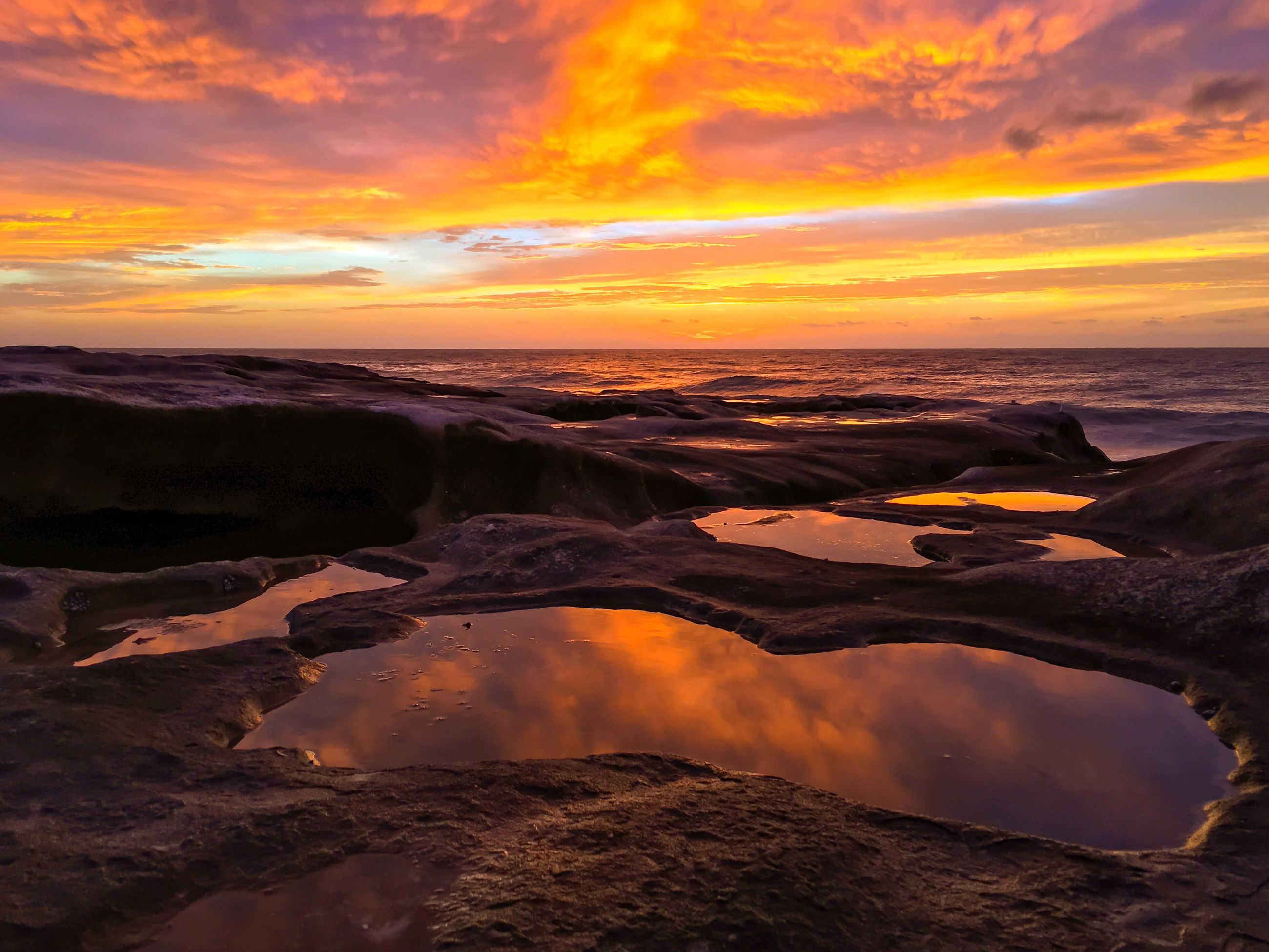 sunset, water, scenics, sea, horizon over water, beach, tranquil scene, beauty in nature, orange color, cloud - sky, idyllic, dramatic sky, tranquility, sky, atmospheric mood, nature, shore, majestic, non-urban scene, romantic sky, reflection, remote, atmosphere, calm, seascape, vibrant color, cloudy, outdoors, wave, tide