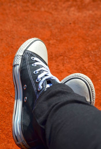Low section of man in canvas shoes