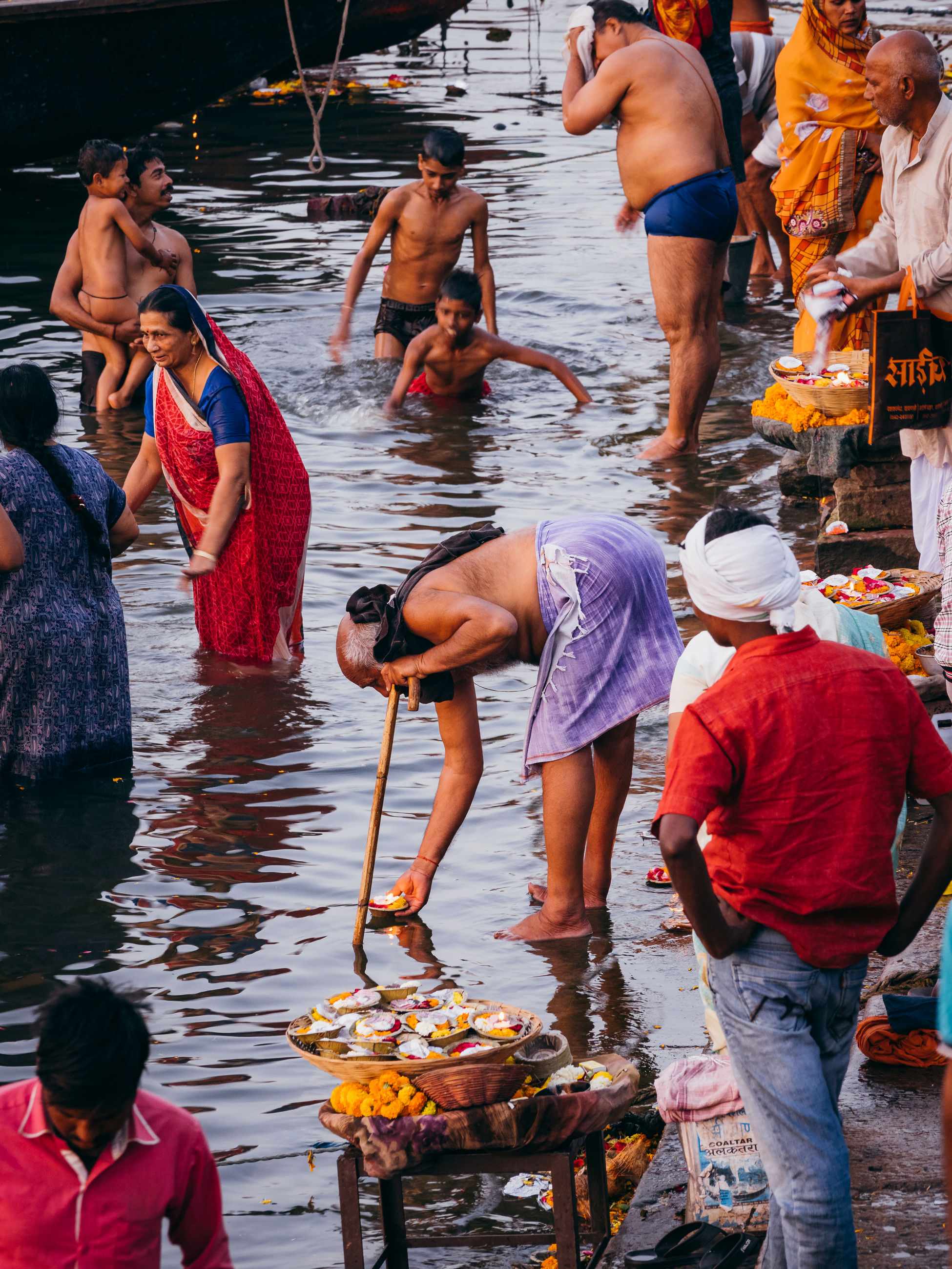group of people, real people, water, large group of people, men, day, crowd, women, occupation, lifestyles, retail, food, market, outdoors, adult, belief, casual clothing, religion