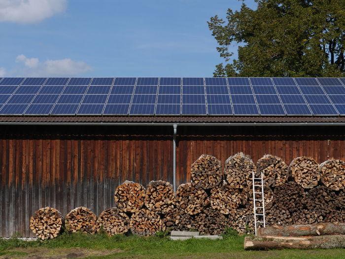 Bundles of firewood outside barn