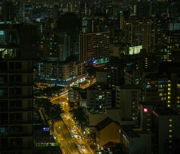 High Angle View Of Illuminated Street By Buildings At Night