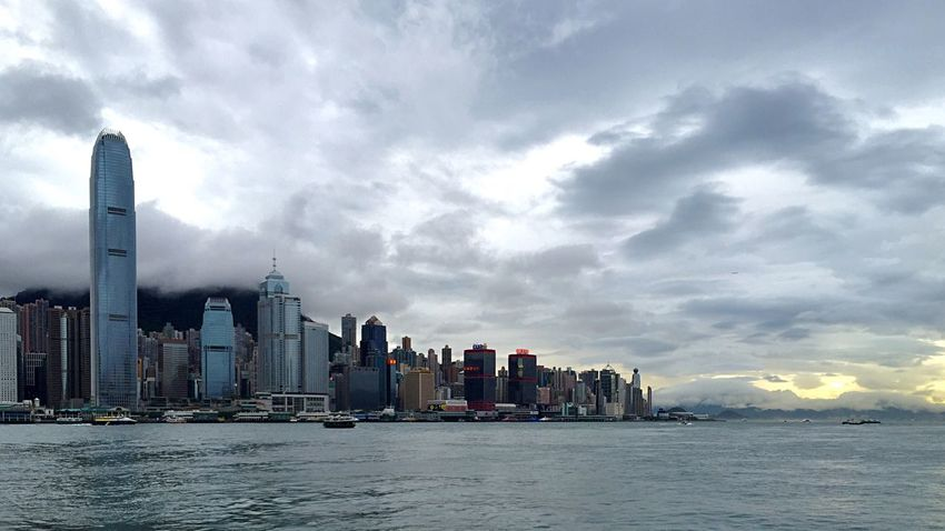 Enjoying The Sights Light And Shadow Hong Kong Skyline Light And Shadows IPhoneography City At Dusk Sunset Buildings & Sky Hong Kong Architecture Victoria Harbour Clouds And Sky