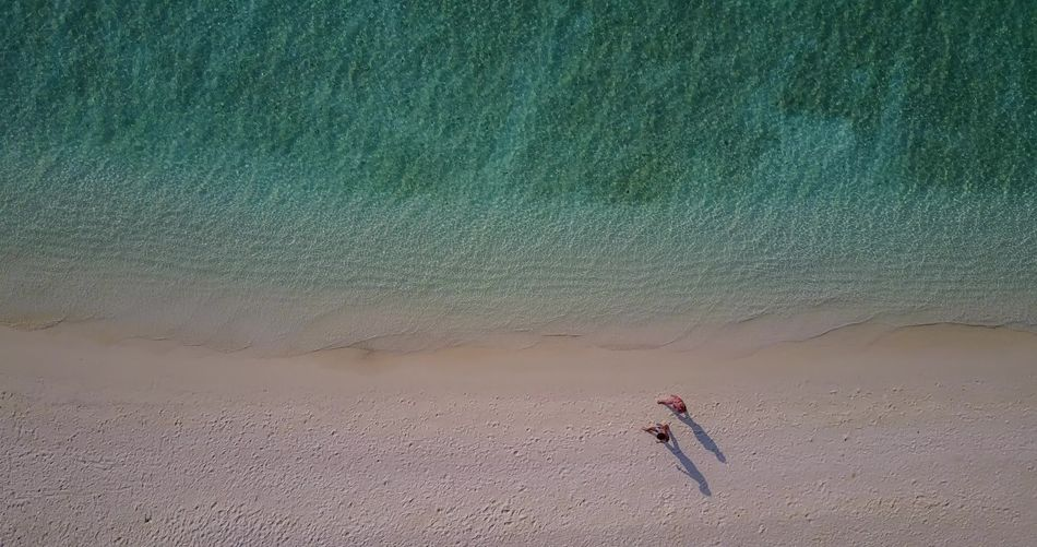 Aerial flying drone view of Maldives white sandy beach on sunny tropical paradise island with aqua blue sky sea Aerial Aqua Beach Blue Drone  Flying Landscape Maldives Ocean Park Sandy Sea Sky Summer Sunny Tropical View Water White