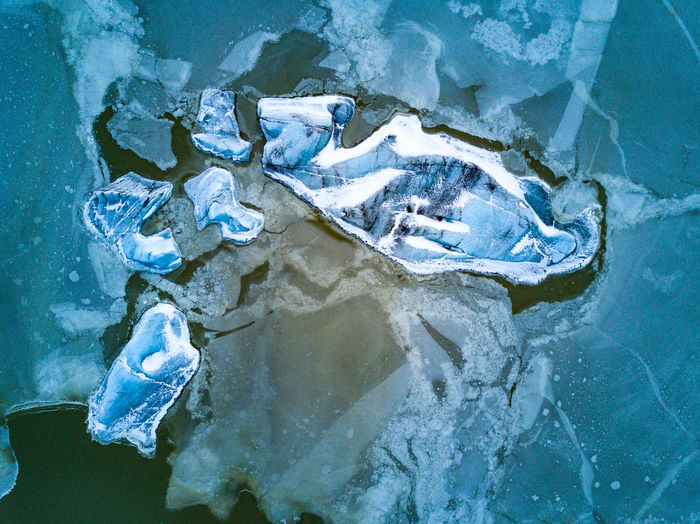 "Composition in ice. The air was freezing. The remote control warned me the battery on the drone was too cold. Looking down, the fading daylight played around these massive chunks of ice. The image reminded me of a broken window. Or an abstract modernist painting. With no people around, these mountains of ice looked so much smaller from above. Battery low... (DJI FC220 26.3mm f/2.2 ƒ/2.2 4.7mm 1/140"" iso 100) Abstract Arctic Blue Copy Space Dronephotography Environment Flying Frozen Glacier Ice Iceberg Iceland Looking Down Mavic Pro Nature No People Outdoors Scandinavia Vatnajökull Water Winter The Week On EyeEm The Great Outdoors - 2017 EyeEm Awards Lost In The Landscape Shades Of Winter"