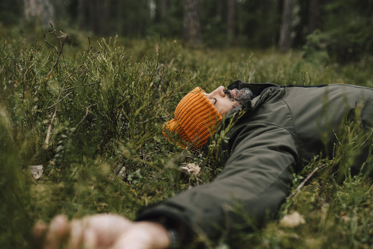 Surface level of man relaxing on field