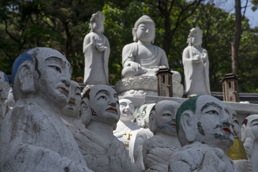 View of Bomunsa, a famous Buddhism temple at Seokmodo in Ganghwado, Kimpo, Gyeonggido, South Korea Bomunsa Buddhism Temple Seokmodo South Korea Architecture Art And Craft Belief Buddhism Craft Creativity Day Female Likeness Ganghwado Human Representation Idol Male Likeness No People Place Of Worship Religion Representation Sculpture Solid Spirituality Statue Stone Material Temple Tree