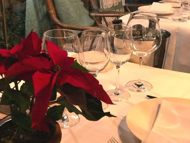 Wineglass Table Indoors  Wine Restaurant Drink No People Food And Drink Refreshment Drinking Glass Alcohol Arrangement Close-up Place Setting Flower Day Freshness Christmas Decoration