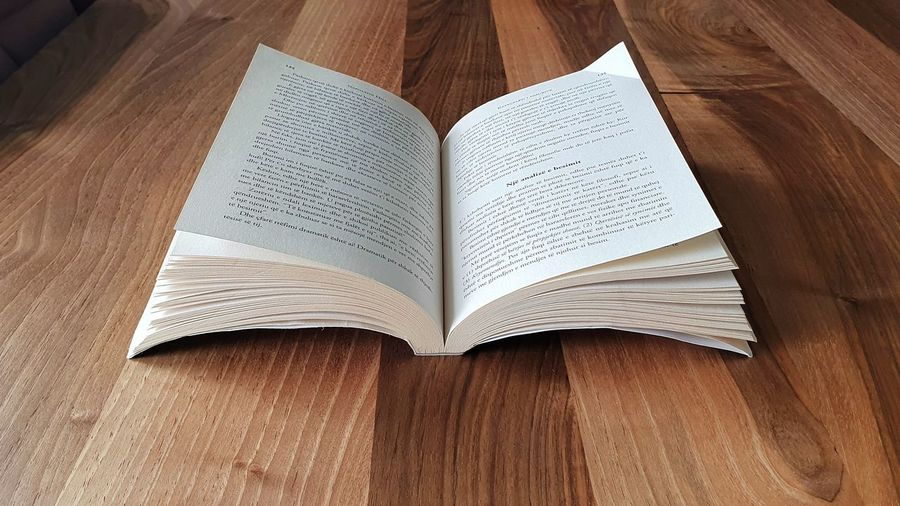 High angle view of open book on table