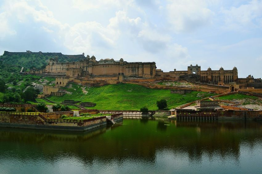 Breathtaking view of the majestic Amer Fort Palace Jaipur. Amerfortjaipur Up Close Street Photography Fort India Jaipur Rajasthan Clouds And Sky Dramatic Sky Lake View Lakeshore