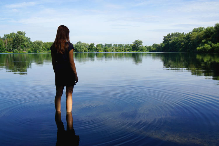 Bathing Pond Beauty In Nature Casual Clothing Day Enjoying Nature Girl Idyllic Lake Lake View Lakeshore Leisure Activity Lifestyles Local Recreation Nature Outdoors Rear View Recreation  Remote Ripples Scenics Solitude Standing Tranquility Water Woman