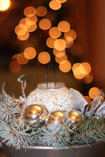 Close-up of illuminated christmas decorations at night