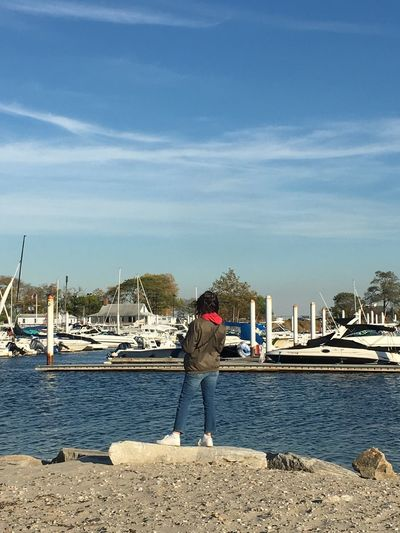Looking out Water Rear View Nautical Vessel Sea Sky Day Full Length Transportation Real People Standing Outdoors One Person Mode Of Transport Casual Clothing Built Structure Harbor Nature Architecture Moored