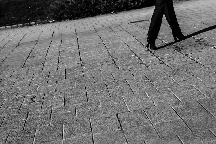 Cobblestone Day Footpath High Angle View Leisure Activity Lifestyles Low Section Outdoors Paving Stone Road Shadow Sidewalk Standing Street Sunlight The Way Forward Up Close Street Photography Unrecognizable Person Walking
