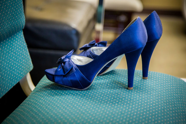 Close-Up Of Blue High Heels On Chair