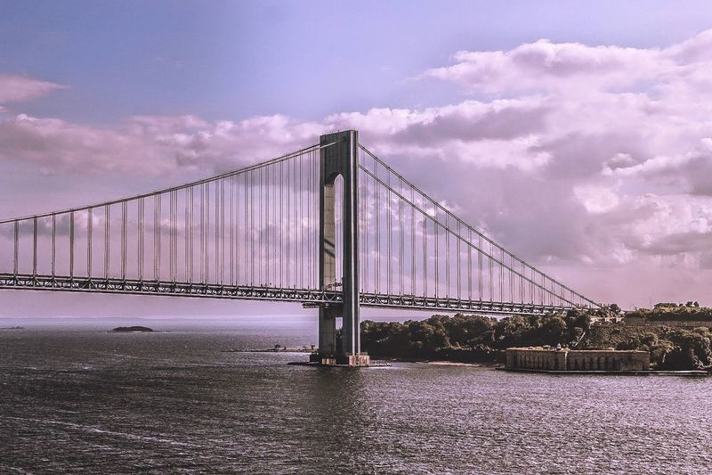 Verrazano–narrows bridge over hudson river against sky